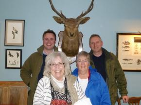 Archie with some clients (and a stag!) near Loch Lomond...