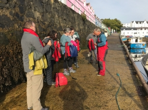 A group getting ready for a sailing trip from Portree on Skye!
